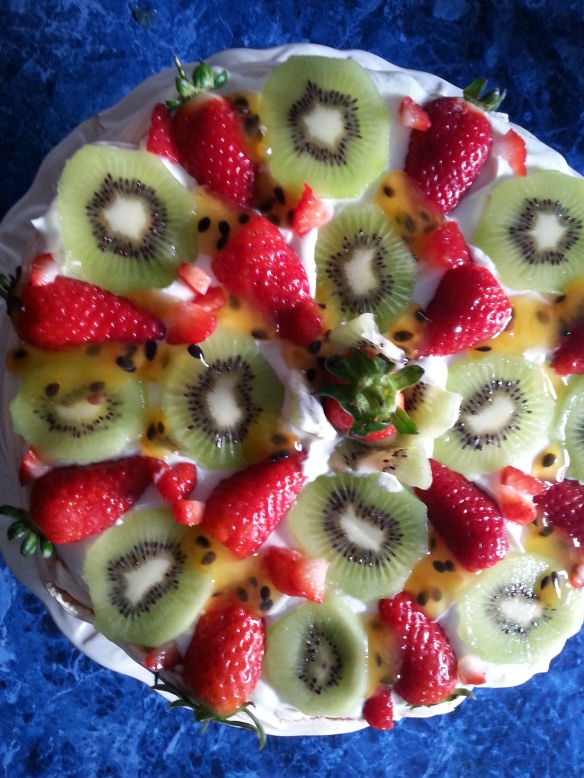 The top layer with cream and fruit.