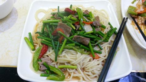 Noodles. The green is the top part of garlic. With beef and peppers. (Image credit: Faatimah H)